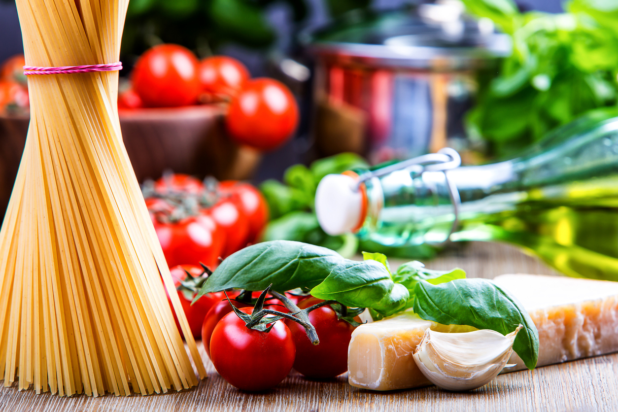 Some ingredients of Italian cuisine.Basil leaves garlic pene and cherry tomatoes
