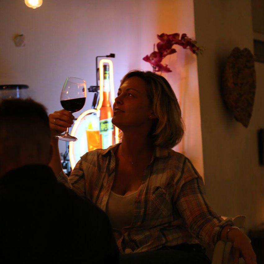 woman drinking wine at italian restaurant miami Via Verdi