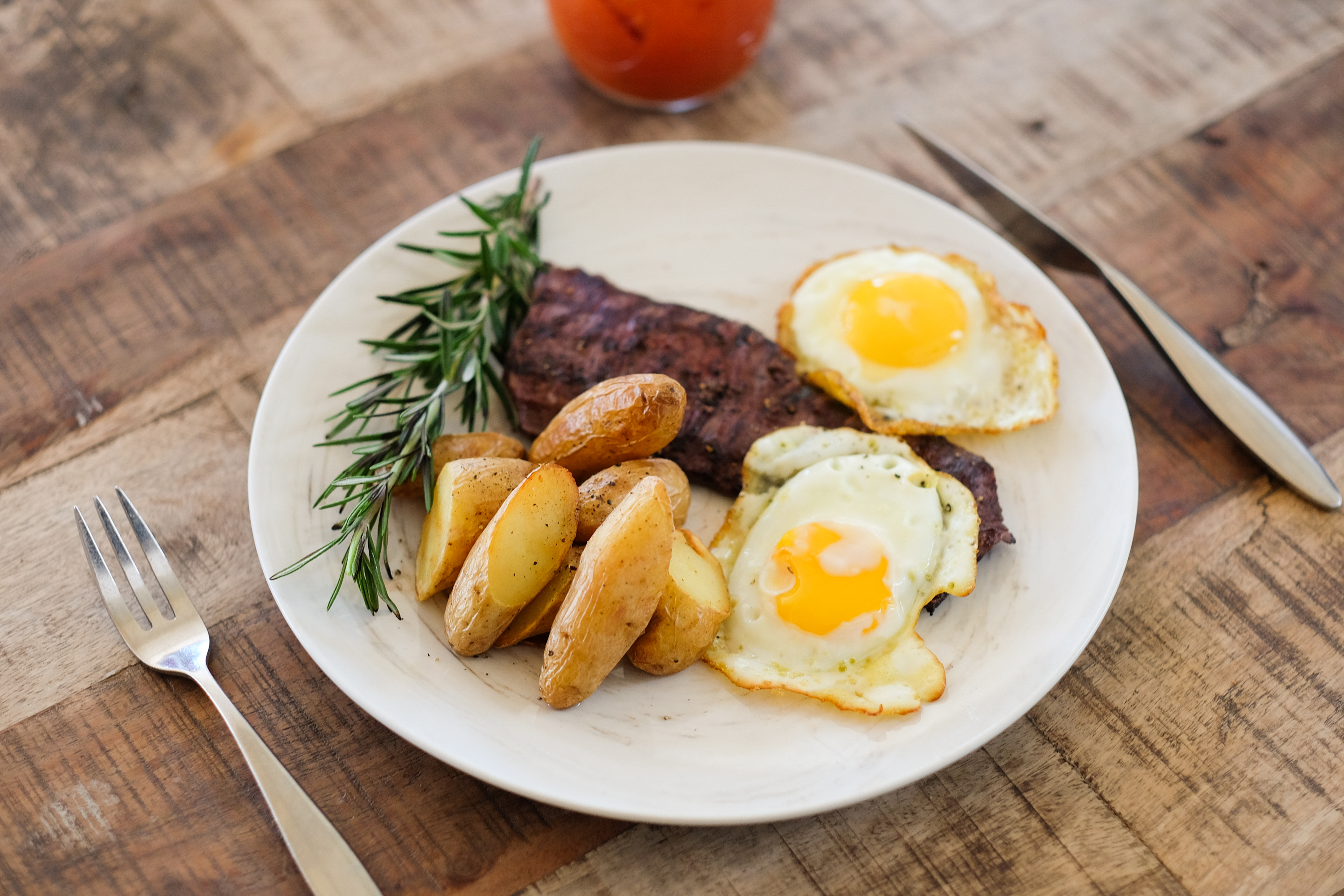 Image of Sunday Brunch served at Via Verdi, Italian restaurant in Miami. 8 oz skirt steak, fried eggs, grilled rustic potatoes, mustard sauce.