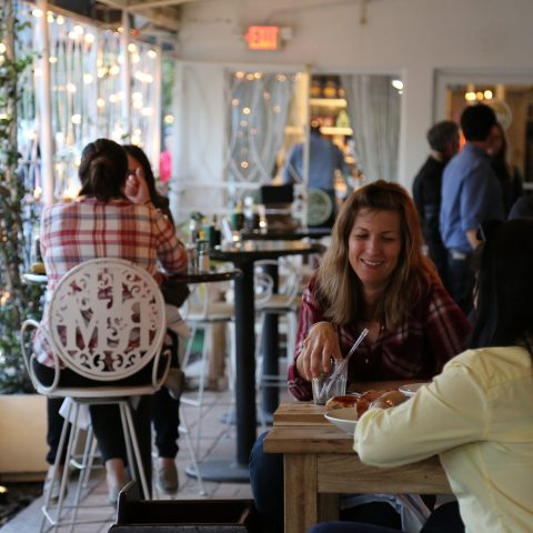 Image of people eating Italian food in an Italian restaurant in Miami.